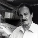 Contactee Howard Menger displays his flying saucer prototype contstructed in his garage