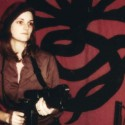 Patty Hearst as Tania posing with the Symbionese Liberation Army flag